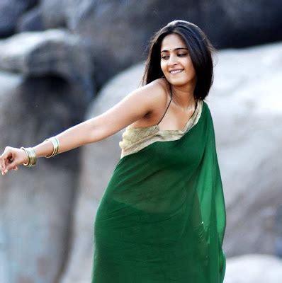 anushka gorgeous green saree stills anushka hot navel
