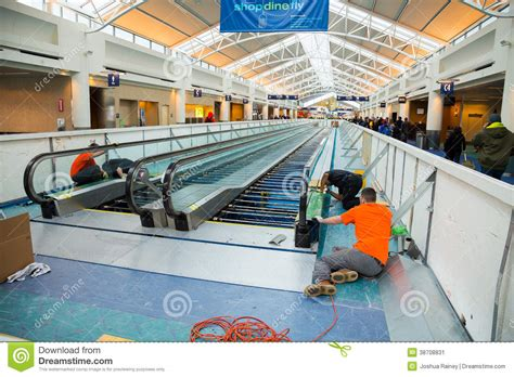 l repair portland or construction workers repair people mover editorial photo