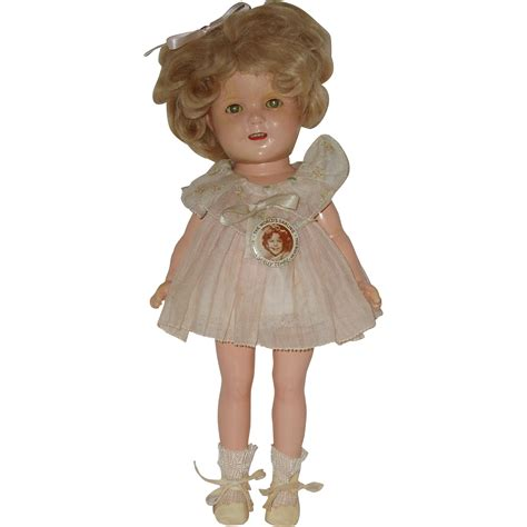 shirley temple doll 13 quot composition shirley temple doll with original tagged dress circa from fantastiques on ruby lane