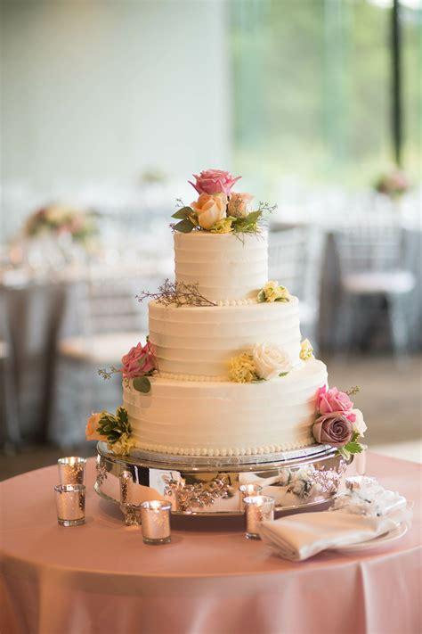 tiered buttercream cake  pastel fresh flowers