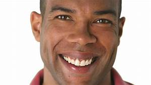 Closeup portrait of smiling African American man's face ...