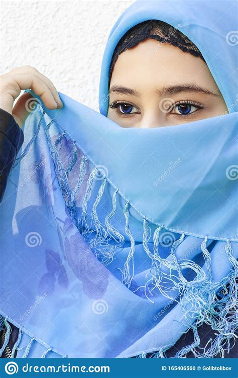 Close Up Portrait Of Beautiful Iranian Girl With Blue Eyes