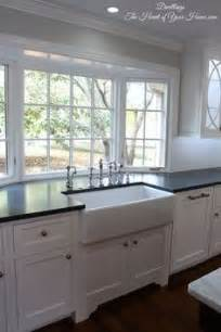 corner kitchen sink pictures this kitchen with white shaker style cabinets 5852