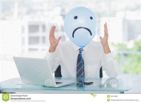 blue balloon  sad face hiding angry businessmans face
