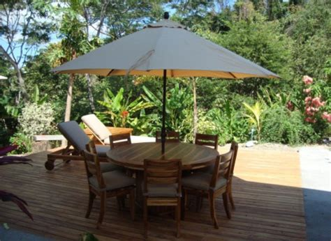 teak outdoor peninsula  dining table  chairs