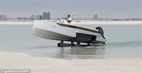 Drink Boat Fuel by Iguana 29 Has Caterpillar Tracks To Travel Land And