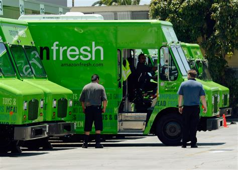 amazon delivery fresh grocery london food amazonfresh same whole foods service truck prime launches warehouse deliver parts getty business companies