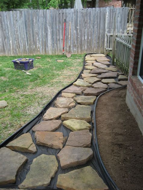building a gravel path gravel in backyard then put down paper to prevent weeds and then we had to put all the