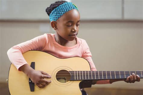 Musical munchkins, 361 danforth ave, toronto, on m4k 1p1, canada. Child-Practicing-Acoustic-Guitar-Music-Lesson - Elite Music Academy   Music Lessons in Toronto