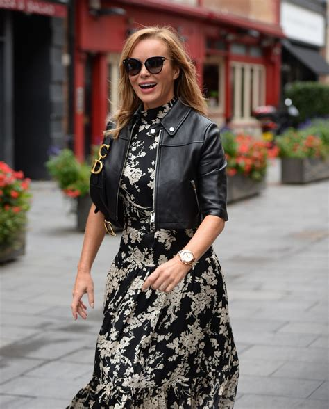She turned heads for all the right reasons in her elegant outfit. Amanda Holden in a Floral Monochrome Dress - London 09/03/2020 • CelebMafia