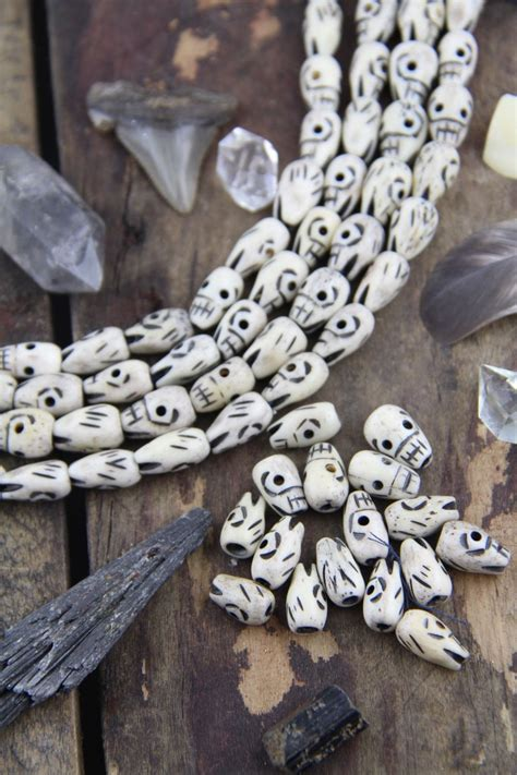 teardrop skull carved bone beads xmm  pieces