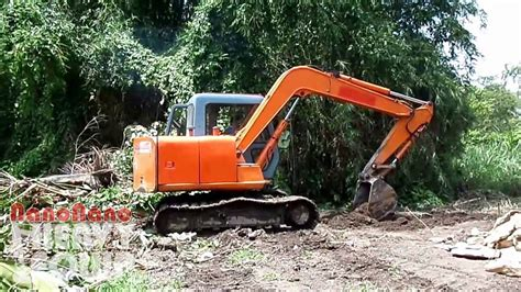 mini excavator hitachi dredging dirt   farm youtube