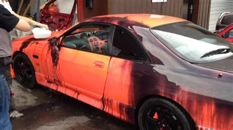 chagne color car nissan skyline covered with heat sensitive paint changes