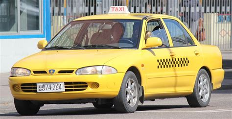 Proton Wira Taxi In Pyongyang, North Korea.jpg