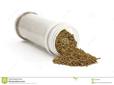 caraway seeds spilling from jar royalty free stock photo