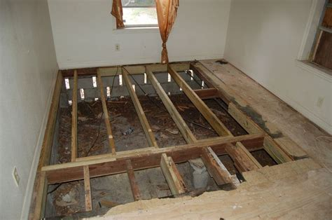 AFTER   damaged subfloor replaced. Now, a layer of sturdy