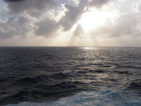 photo sunset ocean stormy sea clouds