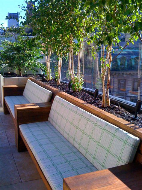 nyc townhouse garden roof terrace stone patio bench container plants birch contemporary