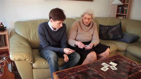 Stock Video Of Grandson And Grandmother Playing Cards