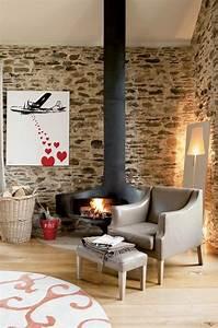 Kaminofen Selbst Verkleiden : natursteinwand im wohnzimmer der nat rliche charme von ~ Michelbontemps.com Haus und Dekorationen