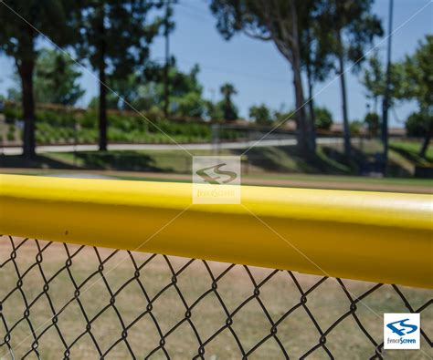 yellow chain link fence topper  baseball outfield fences