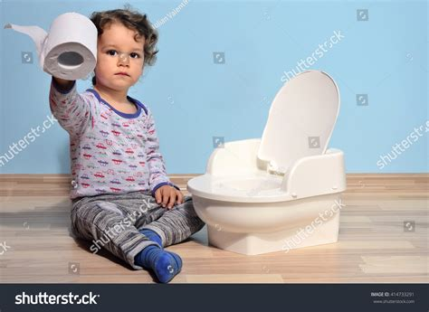 kid pee toilet cute kid potty training pee poobaby stock photo 414733291