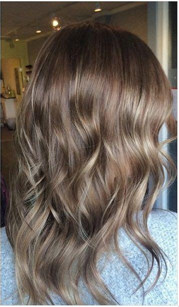 natural brunette hair color  subtle highlights