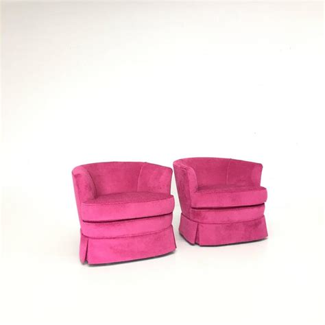 pair of pink mod velvet swivel chairs for sale at