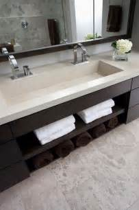 the sink is integrated into one of concrete and has his and faucets the