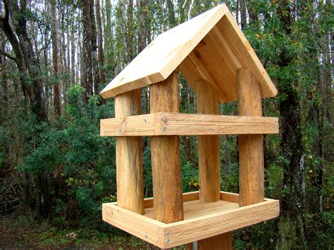 large rustic wood platform bird feeder has 2 levels use as a