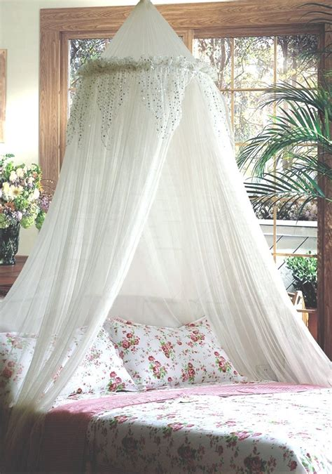 white bed canopy with silver sequinned valance