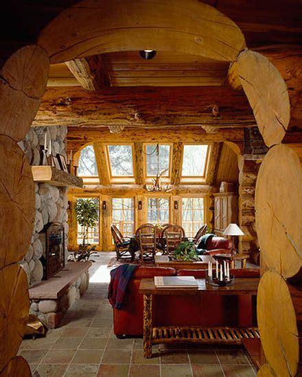 log home sun rooms sunroom log arch stone fireplace skylights tile floor log mantle