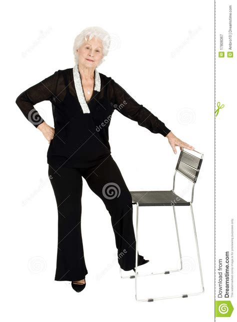 elderly standing near a chair royalty free