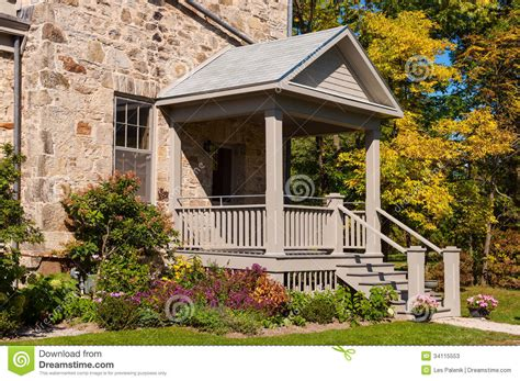 house porch  colorful flowers  trees stock image