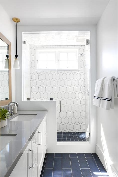 blue grid shower floor tiles  white geometric wall