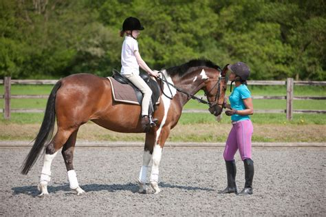 riding lessons horseback young instructor child children horse horses ride lesson equestrian take helmets learn gear getty outfits appropriate age
