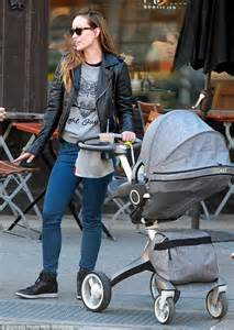 Olivia Wilde looks cool in a leather biker jacket as she ...