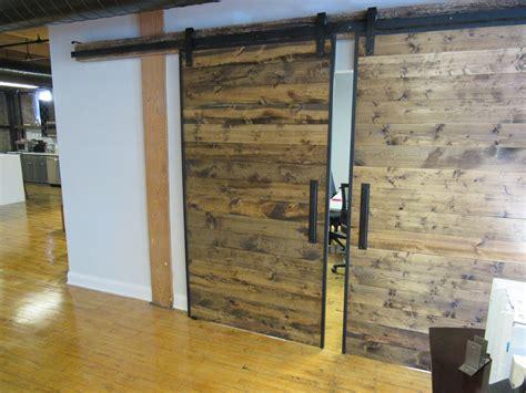 handmade industrial reclaimed barn doors on steel track by
