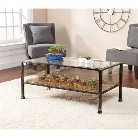 Must allow for proper air circulation. Amazon.com: Southern Enterprises Terrarium Display Cocktail Coffee Table, Black with Silver ...