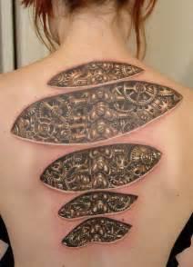 skin design biomechanical ripped skin gear design on back tattooshunt