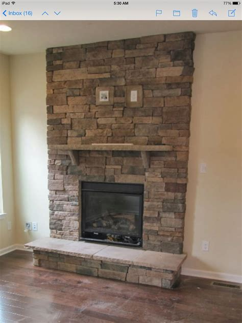 stacked stone fireplace  tv mount   wall