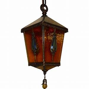 Tudor brass and amber glass with jewels pendant light from