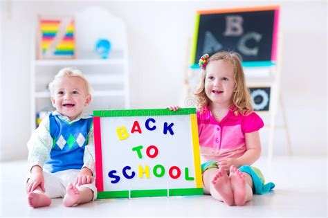 at preschool painting stock photo image of 105 | kids preschool painting two children drawing kindergarten boy girl happy to go back to school toddler kid baby 55567632