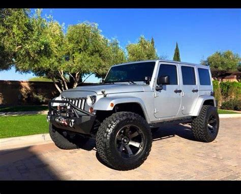 silver jeep lifted silver jeep jk with modified whels grill lift jeep jk