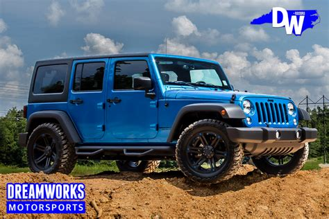 white jeep with teal accents jeep dreamworks motorsports