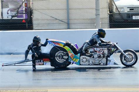 Astonishing Moment Drag Racer Clings Onto Opponent's