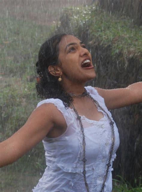 actress nithya kalyani hot photos nithya menon new wet photos in rain song