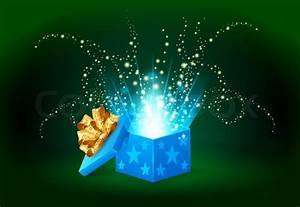 Beautiful magic light shining from a blue gift box Stock