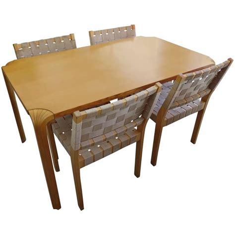 alvar aalto dining table alvar aalto fan leg dining table with four chairs for sale