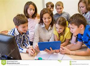 Group Of Kids With Teacher And Tablet Pc At School Stock ...